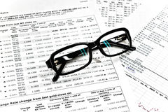 Glasses and financial documents Stock Photography