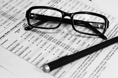 Glasses, Financial Documents And Pencil Stock Images