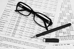 Glasses, financial documents and pencil Royalty Free Stock Photo
