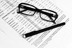 Glasses, financial documents and pencil Royalty Free Stock Photography