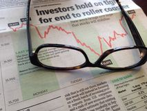 Glasses on Financial Paper Royalty Free Stock Photos