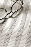 Glasses on Financial Spreadsheet with Figures Royalty Free Stock Image