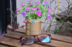 Glasses and Flower vase on table. In garden of coffee shop Royalty Free Stock Photography