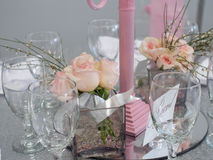 Glasses & Flowers. A closeup picture of a beautiful table set up with wine glasses and pick roses Stock Image