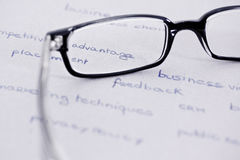Glasses with focus on competitive advantage. Business words with glasses focusing on competitive advantage Royalty Free Stock Photos