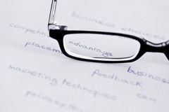 Glasses with focus on competitive advantage. Business words with glasses focusing on  competitive advantage Royalty Free Stock Photo