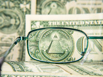 Glasses focused on dollar banknote with pyramid, detail Stock Images