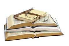 Glasses on four books Royalty Free Stock Images