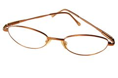 Glasses, frame, health, sight, medicine, fashion. Glasses in the golden or bronze frame, isolated on a white background Royalty Free Stock Image