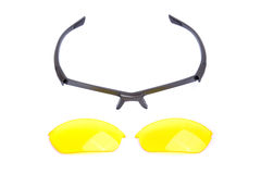 Glasses frame and lens. Glasses frame and yellow lens. Isolated on white royalty free stock photos