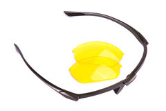 Glasses frame and lens. Glasses frame and yellow lens. Isolated on white royalty free stock photo
