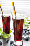 Glasses with fresh Black Currant juice. Bog blueberry and lemon balm Royalty Free Stock Photography