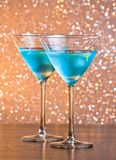 Glasses of fresh blue cocktail with ice on bar table Stock Photo