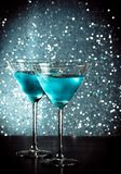 Glasses of fresh blue cocktail with ice on bar table Stock Photos