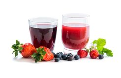 Glasses of fresh blueberry and strawberry juice. With berries on white Stock Photos