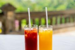 Glasses of fresh fruit juice at restaurant Royalty Free Stock Photos