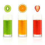 Glasses with fresh fruit juices Stock Images