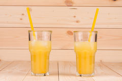 Glasses of fresh orange juice Stock Photos