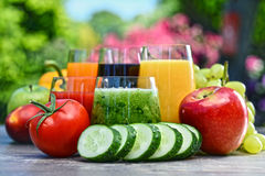Glasses with fresh organic detox juices in the garden Stock Photo