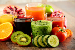 Glasses of fresh organic vegetable and fruit juices Stock Photography