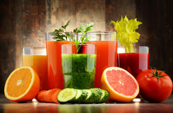 Glasses with fresh organic vegetable and fruit juices Stock Photos