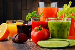 Glasses with fresh organic vegetable and fruit juices Stock Image