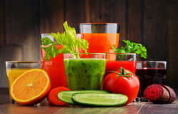 Glasses with fresh organic vegetable and fruit juices Stock Photography