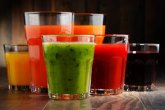 Glasses with fresh organic vegetable and fruit juices Royalty Free Stock Image