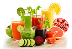 Glasses with fresh organic vegetable and fruit juices on white Stock Image