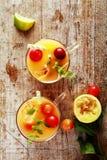Glasses of fresh summer fruit cocktail Stock Photos