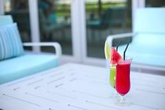 Glasses of fresh fruit juice. Glasses of fresh t juice. Close up Royalty Free Stock Photo