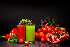 Glasses with fresh vegetable juices isolated on black. Detox. Diet Stock Photo