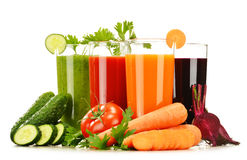 Glasses with fresh vegetable juices isolated on white Royalty Free Stock Photos