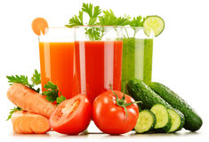 Glasses with fresh vegetable juices isolated on white Stock Photography