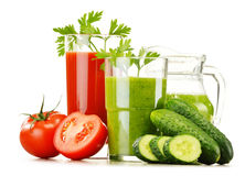Glasses with fresh vegetable juices isolated on white Royalty Free Stock Photography