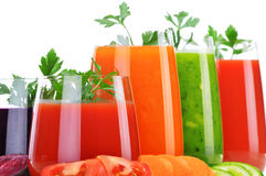Glasses with fresh vegetable juices isolated on white Stock Photo