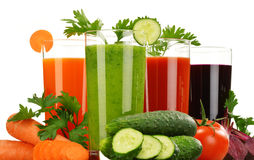 Glasses with fresh vegetable juices isolated on white Royalty Free Stock Photo