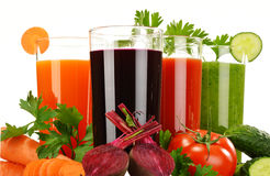 Glasses with fresh vegetable juices isolated on white Stock Images