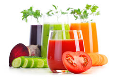 Glasses with fresh vegetable juices on white Royalty Free Stock Photos