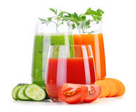Glasses with fresh vegetable juices on white Royalty Free Stock Images