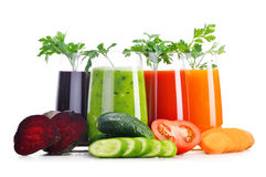 Glasses with fresh vegetable juices on white Royalty Free Stock Photography