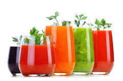 Glasses with fresh vegetable juices on white royalty free stock image