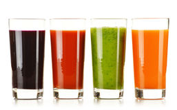 Glasses with fresh vegetable juices on white Stock Images