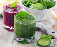 Glasses of Freshly Squeezed Vegetable Juices on a wooden table Stock Photo