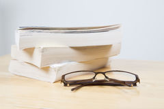 Glasses in front of books Royalty Free Stock Images