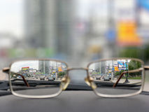 Glasses on front panels of car. In city stock photography