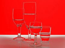 Glasses in front of a red and white background stock photos
