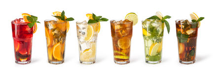 Glasses of fruit drinks with ice cubes Stock Photography