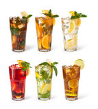 Glasses of fruit drinks with ice cubes Stock Images