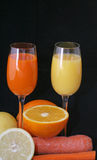 Glasses of fruit juice. And slices of fruit stock photos